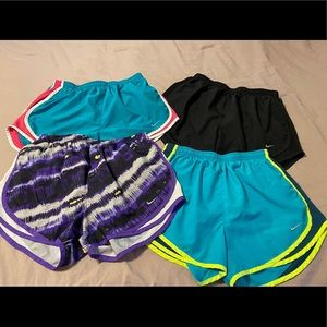 Nike Shorts - 🏃🏻‍♀️Lot of 4 women's Nike shorts. Size Medium